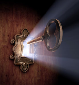 A close-up of a key moving towards the key hole.